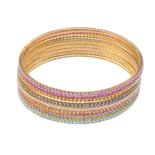 1116 - (131747-1-A) Nine variously gem-set bangles. Inner diameter 6.5cms. Weight 58.3gms.  <br>Please be a...