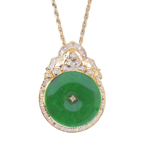 1120 - (131747-1-E) A diamond and jade pendant. Designed as a jade bi, with diamond centre, floral surmount...