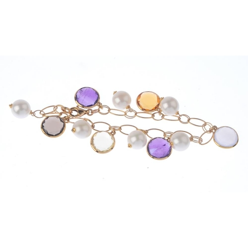 1121 - (131747-1-F) A cultured pearl and gem-set bracelet. Designed as an alternating cultured pearl and va...