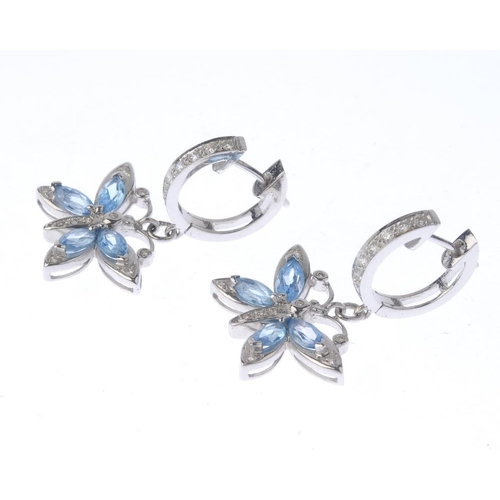 1126 - (131747-1-K) A pair of diamond and gem-set earrings. Each designed as a marquise-shape blue gem and ...
