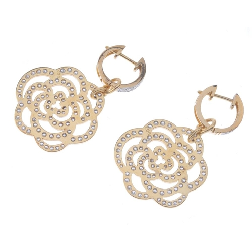 1127 - (131747-1-L) A pair of diamond floral earrings. Each designed as a brilliant-cut diamond stylised ro...
