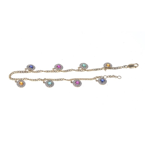 1129 - (131747-1-N) A diamond and gem-set cluster charm bracelet. Comprising an alternating series of citri...