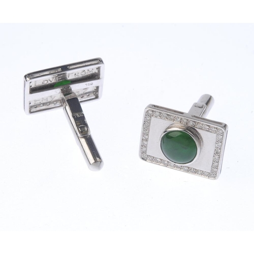 1130 - (131747-1-O) A pair of jade and diamond cufflinks. Each designed as a circular jadeite cabochon, wit...