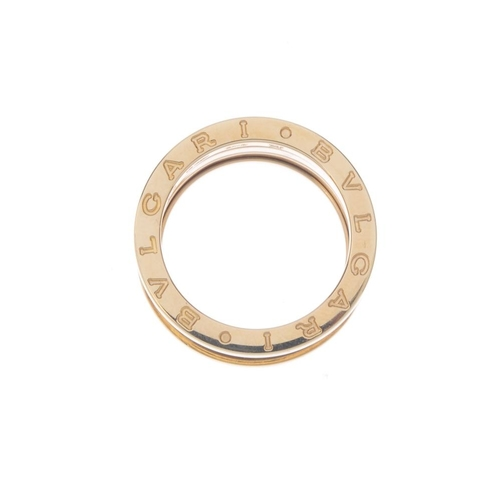 1132 - (131747-1-R) BULGARI- a 'B.Zero1' band ring. The articulated spiral band, with raised border and Bul...