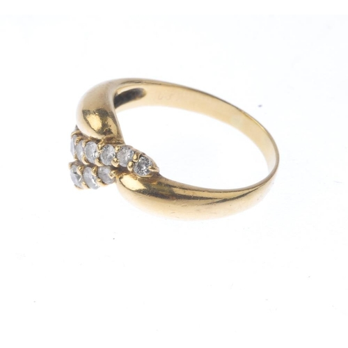 1138 - (132166-2-A) A diamond ring. Of abstract design, the brilliant-cut diamond curved lines and tapered ...