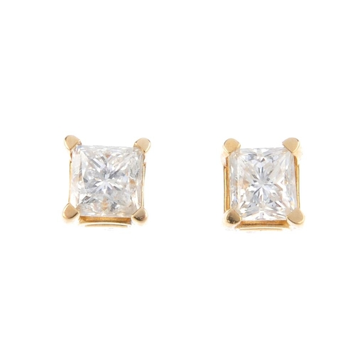 114 - A pair of square-shape diamond stud earrings. Total diamond weight 0.50ct, estimated H-I colour, SI2...
