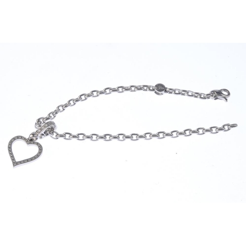 1143 - (132442-2-A) THEO FENNELL - An 18ct gold diamond charm and bracelet. The brilliant-cut diamond heart...