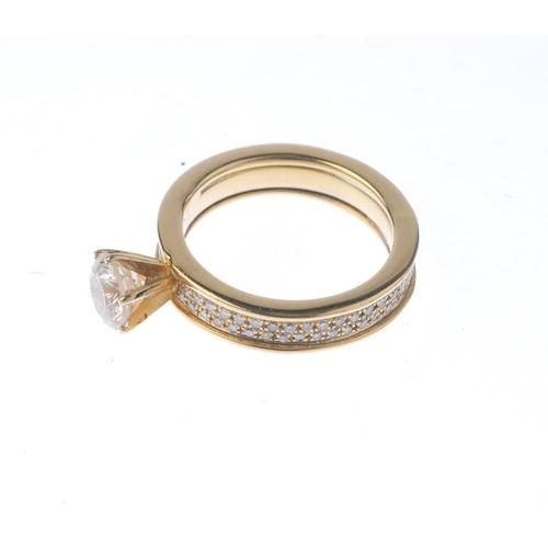 1147 - (132442-6-A) A diamond ring. The brilliant-cut diamond, with a similarly-cut diamond band. Principal...