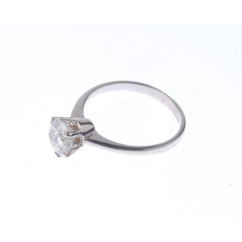 1148 - (132442-7-A) A diamond single-stone ring. The brilliant-cut diamond, with tapered band. Estimated di...