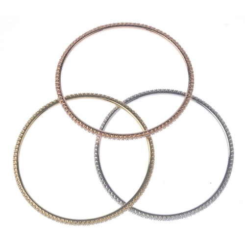 1153 - (132790-1-A) Three diamond bangles. Each designed as a series of brilliant-cut diamonds. Estimated t...