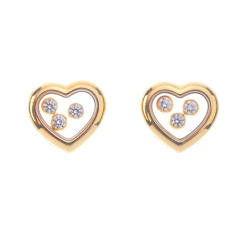 1155 - (132079-2-A) CHOPARD - a pair of 'Happy Diamond' earrings. Each designed as three free moving brilli...
