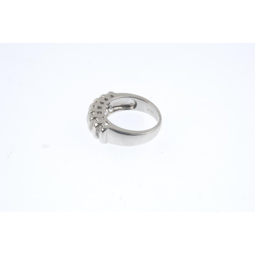 116 - A 9ct gold diamond dress ring. Comprising a series of square-shape and brilliant-cut diamond lines, ...