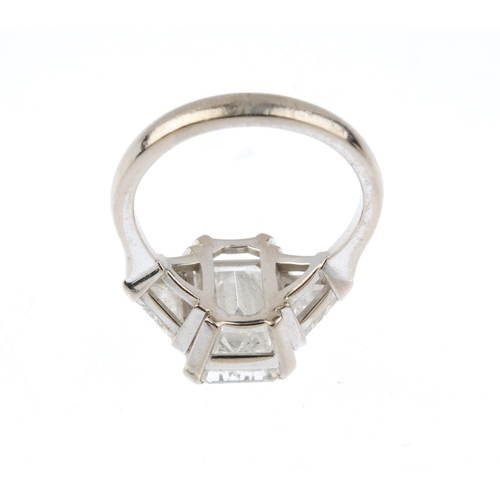 1163 - An 18ct gold diamond three-stone ring. The rectangular-shape diamond, with triangular-shape diamond ...