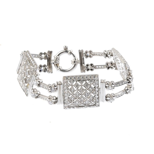 1177 - (3752-6-A) A cubic zirconia bracelet. The cubic zirconia square-shape lattice panels, with alternati...