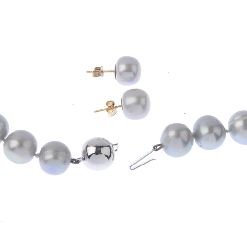 1179 - (3752-8-A) A dyed cultured pearl single-strand necklace. Comprising a series of twenty-nine graduate...