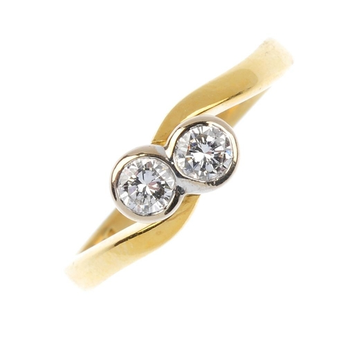 118 - An 18ct gold diamond crossover ring. The brilliant-cut diamond collet diagonal line, with asymmetric...