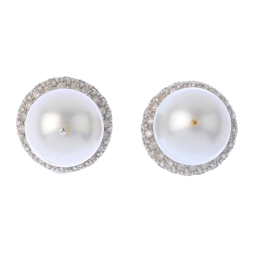 1181 - (4073-1-A) A pair of cultured pearl and diamond earrings. Each designed as a cultured pearl, measuri...