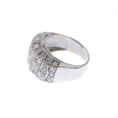 1182 - (4073-2-A) A diamond dress ring. Designed as an angular panel, set with brilliant-cut diamonds and p...