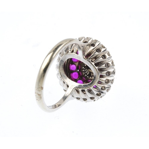1185 - (4073-5-A) A cultured pearl, ruby and diamond cluster ring. The cultured pearl, with circular-shape ...