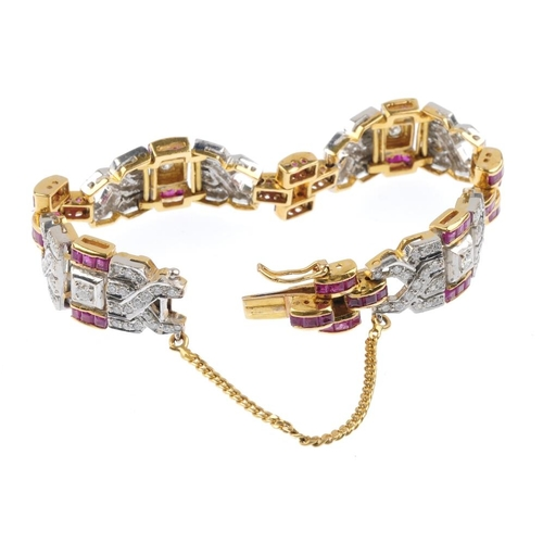 1186 - (4073-6-A) A diamond and ruby bracelet. Of geometric design, the alternating square-shape ruby and b...