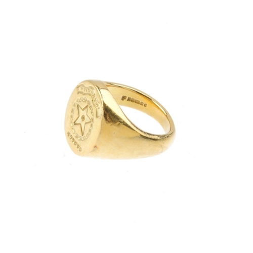 1191 - (4138-1-A) An 18ct gold signet ring. The circular-shape engraved panel, with tapered shoulders. Hall...