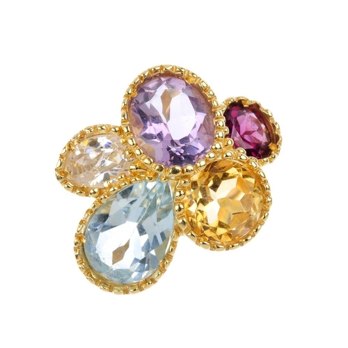 1193 - (4161-3-A) A gem-set dress ring. Designed as a vari-shape blue topaz, amethyst, garnet, cubic zircon...