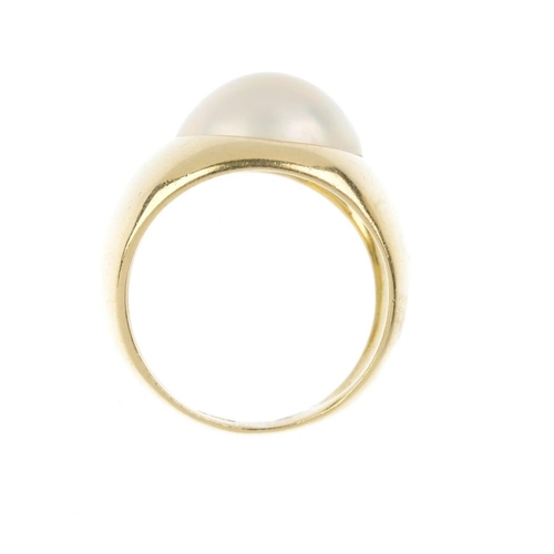 1196 - (4161-6-A) A mabe pearl dress ring. The mabe pearl, inset to the tapered band. Italian marks. Ring s...