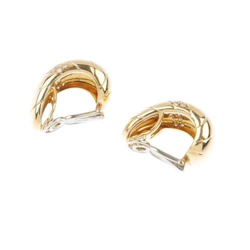 1197 - (4161-7-A) A pair of diamond earrings. Each designed as a brilliant-cut diamond curved line, inset t...