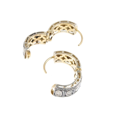1199 - (4161-7-C) A pair of diamond earrings. Each designed as a rose-cut diamond collet hoop, with single-...
