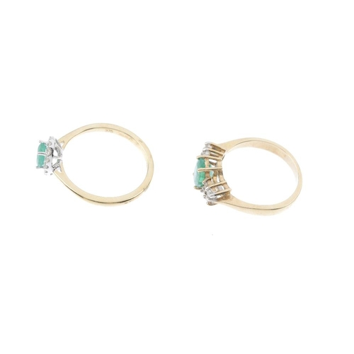 120 - Two 9ct gold emerald and diamond dress rings. The first designed as an oval-shape emerald within a b...