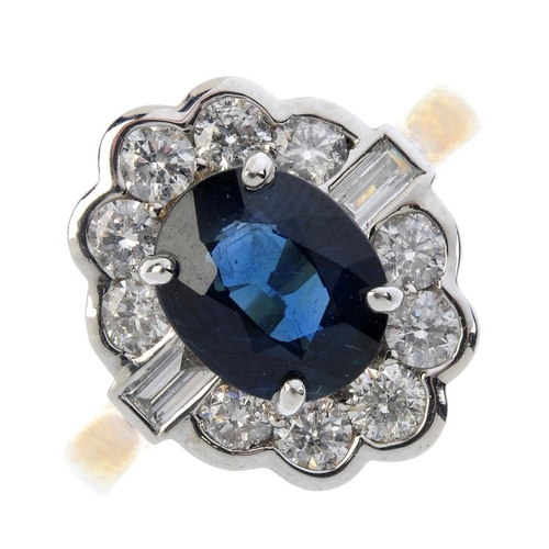 122 - A 9ct gold sapphire and diamond cluster ring. The oval-shape sapphire and brilliant-cut diamond clus...