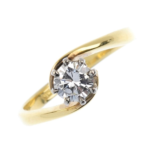 123 - An 18ct gold diamond single-stone ring. The brilliant-cut diamond, with asymmetric shoulders. Diamon...