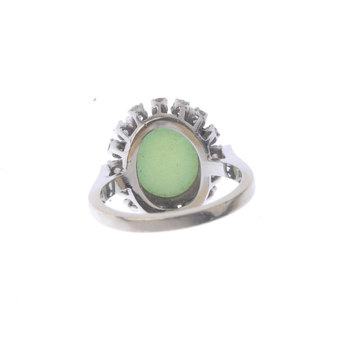 1234 - (401754-5-A) A diamond and gem-set cluster ring. The oval six-ray star green-gem cabochon, with sing...