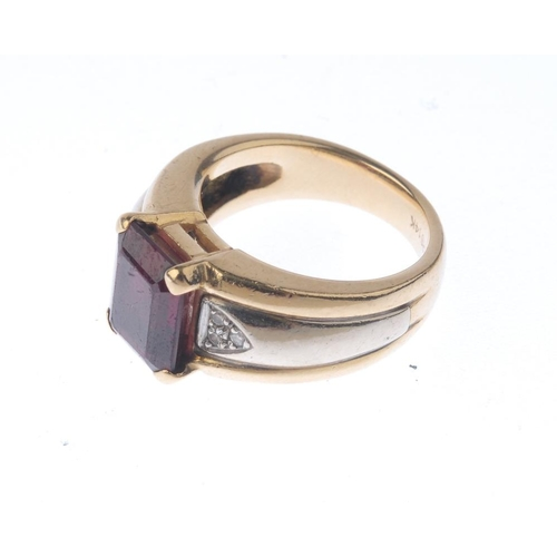 1235 - (401754-6-A) A garnet and diamond ring. The rectangular-shape garnet, with brilliant-cut diamond tre...
