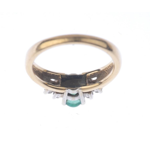 1236 - (401754-7-A) An emerald and diamond ring. The oval-shape emerald, with brilliant-cut diamond trefoil...