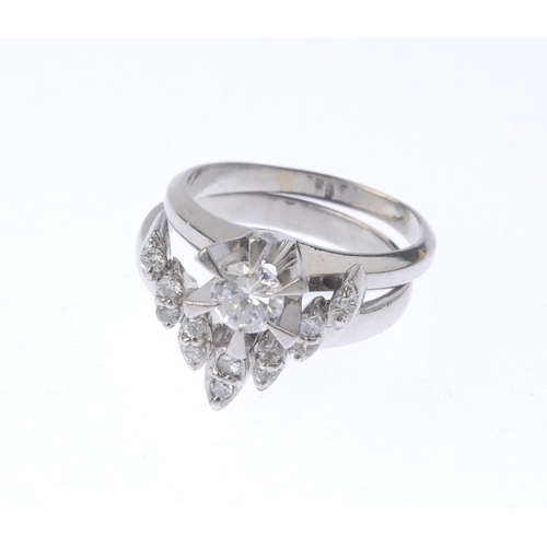 1237 - (401770-1-A) Two diamond rings. To include a brilliant-cut diamond single-stone ring, together with ...