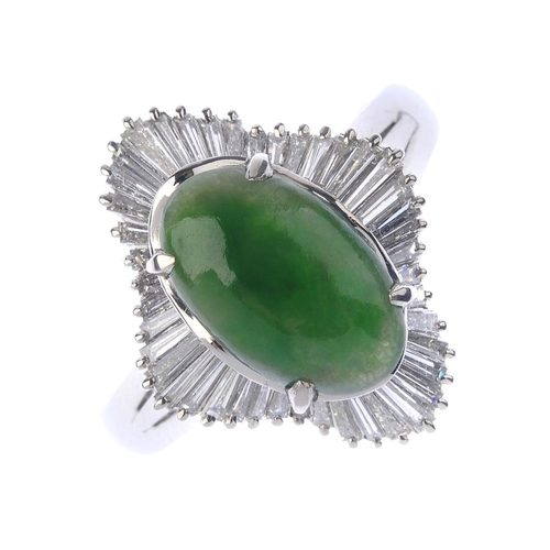 1238 - (401770-2-A) A jade and diamond cluster ring. The oval jadeite cabochon, within a tapered baguette-c...