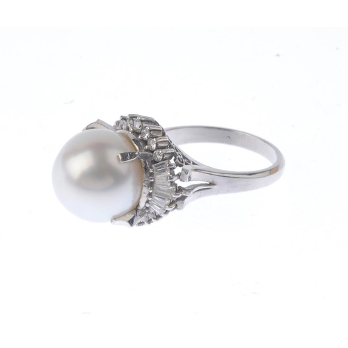 1239 - (401770-3-A) A cultured pearl and diamond ring. Designed as a cultured pearl, with baguette and tape...