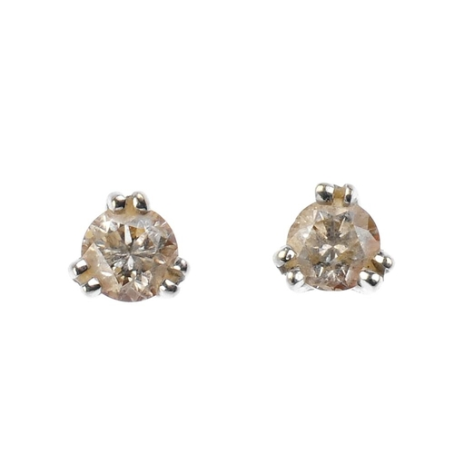 124 - A pair of 18ct gold brilliant-cut diamond stud earrings. Estimated total diamond weight 0.25ct. Hall...