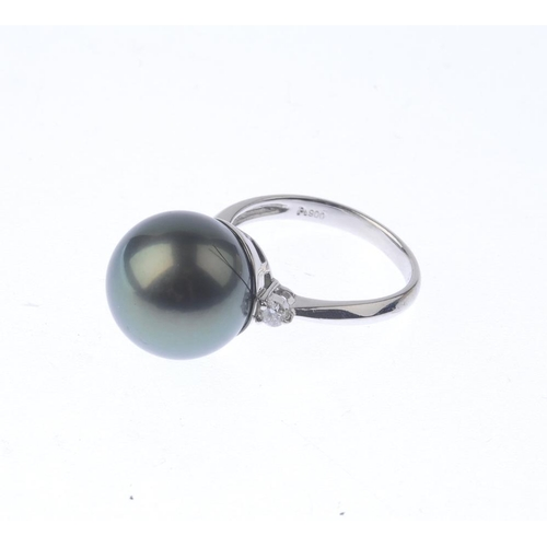 1240 - (401770-4-A) A dyed cultured pearl and diamond ring. The dyed cultured pearl, measuring approximatel...