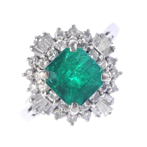 1241 - (401770-5-A) An emerald and diamond cluster ring. The square-shape emerald, with tapered baguette an...