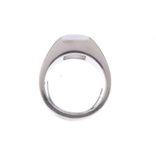 1246 - (401808-1-A) A moonstone dress ring. The square moonstone cabochon, inset to the tapered band. Ring ...