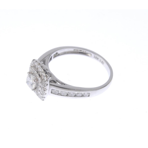 1248 - (401826-1-A) An 18ct gold diamond cluster ring. The brilliant-cut diamond, with similarly-cut diamon...