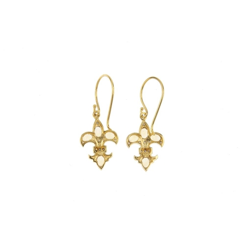 125 - A pair of citrine and diamond fleur-de-lis earrings. Each designed as an oval-shape citrine and sing...