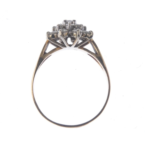 1251 - (401835-2-A) A diamond cluster ring. The brilliant-cut diamond within a similarly-cut diamond double...