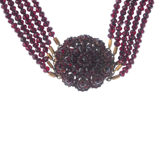 1252 - (401919-1-A) Three items of jewellery. A garnet and paste necklace and earrings with a cultured pear...