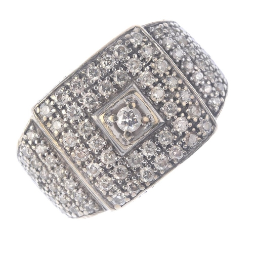 1255 - (545249-1-A) A gentleman's diamond cluster ring. Of square-shape outline, the brilliant-cut diamond,...