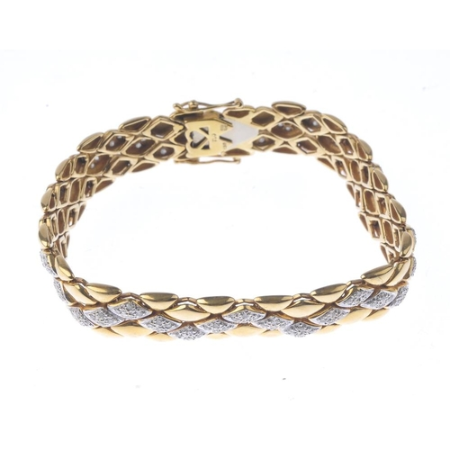 1256 - (546629-3-A) An 18ct gold diamond bracelet. The brilliant-cut diamond geometric line, interspaced by...