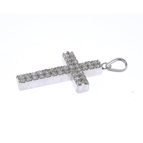 1258 - (546732-2-A) A diamond cross pendant. Designed as a brilliant-cut diamond cross, suspended from a ta...