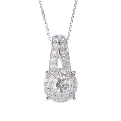 1259 - (546732-3-A) A diamond pendant, with chain. Designed as a brilliant-cut diamond, within a pave-set d...